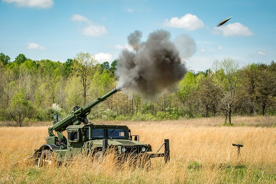 105mm Hawkeye howitzer firing from an AM General HMMWV
