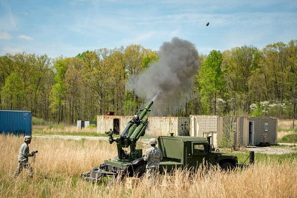 105mm Hawkeye howitzer firing from an AM General HMMWV